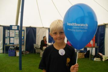 Child with Healthwatch Balloon