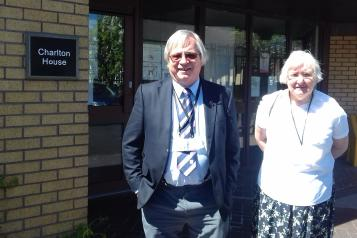 Two of our volunteers outside surgery