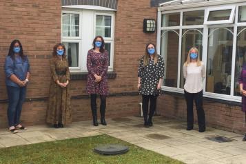Healthwatch County Durham team stood outside wearing masks