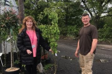 Our volunteer coordinator recieving tree to plant