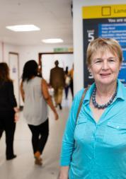 Lady in hospital corridor